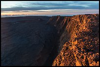 Cliffs bordering Mauna Loa summit caldera from rim at sunrise. Hawaii Volcanoes National Park, Hawaii, USA. (color)