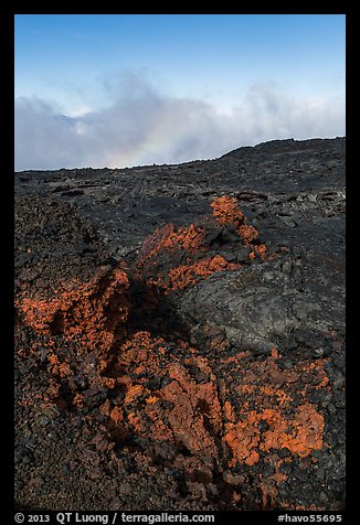Red and orange lava, rainbow in clouds, Mauna Loa. Hawaii Volcanoes National Park (color)