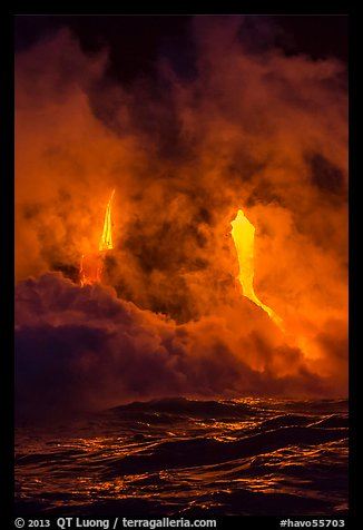 Lava cascading cliffs above ocean waves at night. Hawaii Volcanoes National Park (color)