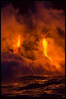 Lava cascading cliffs above ocean waves at night. Hawaii Volcanoes National Park, Hawaii, USA.
