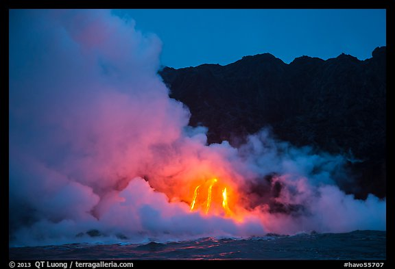Lava flows cascade down sea cliff at dawn. Hawaii Volcanoes National Park (color)