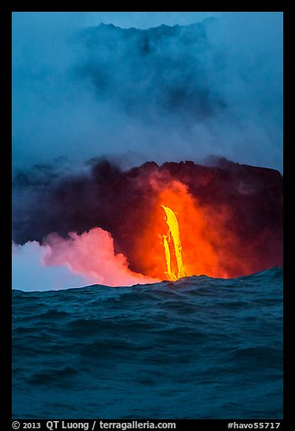 A single spigot of lava creates a large plume steam at sunrise upon reaching ocean. Hawaii Volcanoes National Park (color)