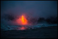 Lava flow at dawn, ocean reflection, and steam plume. Hawaii Volcanoes National Park, Hawaii, USA. (color)