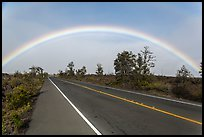 Rainbow over highway. Hawaii Volcanoes National Park, Hawaii, USA. (color)