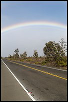 Rainbow above highway. Hawaii Volcanoes National Park, Hawaii, USA. (color)