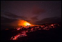 Molten lava flow and plume from ocean entry with stary sky at night. Hawaii Volcanoes National Park ( color)