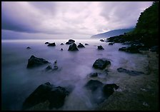 Seascape with smooth water, clouds and rocks, Siu Point, Tau Island. National Park of American Samoa ( color)