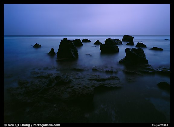Rocks in water at dusk, Siu Point, Tau Island. National Park of American Samoa
