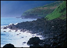 Coastline with Balsalt boulders on the wild South coast of Tau Island. National Park of American Samoa ( color)