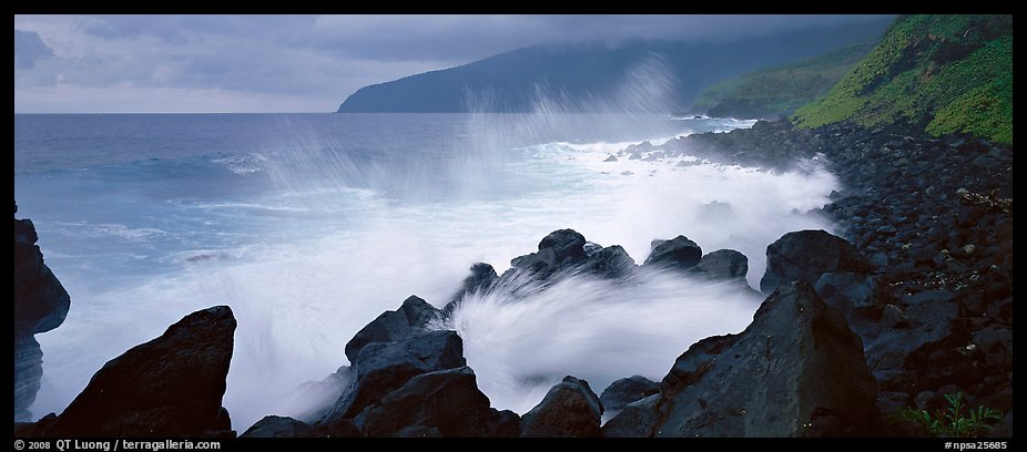 Shoreline with black rock pounded by strong surf, Tau Island. National Park of American Samoa (color)