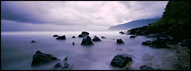 Coast with boulders and storm clouds, Tau Island. National Park of American Samoa (Panoramic color)