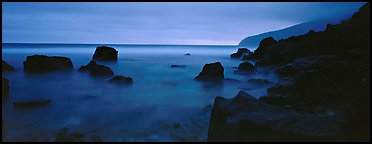 Rugged coastline at dusk. National Park of American Samoa (Panoramic color)
