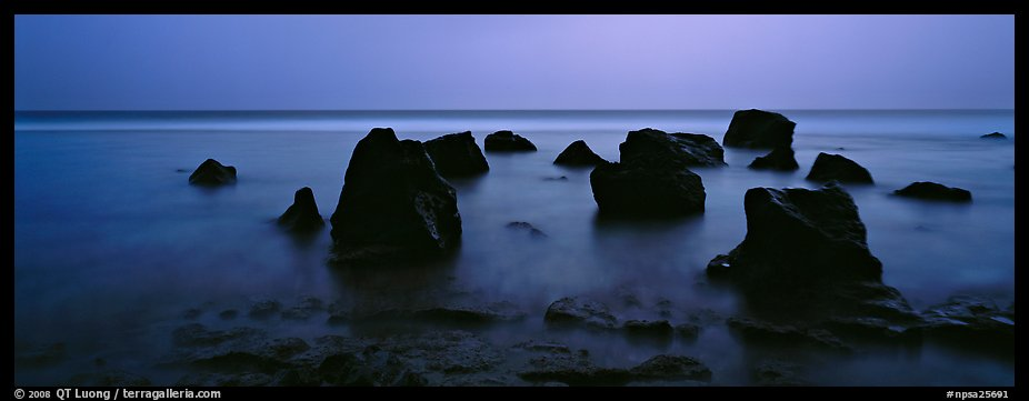 Seascape with boulders in water at dusk. National Park of American Samoa (color)