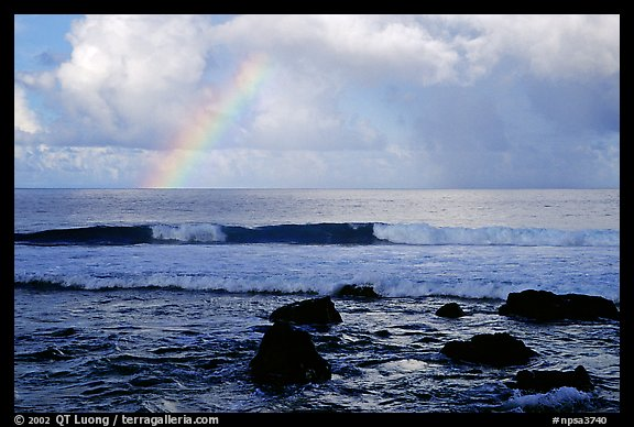 Rainbow and boulders, Siu Point, Tau Island. National Park of American Samoa (color)