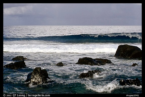 Boulders and surf, Tau Island. National Park of American Samoa (color)