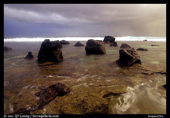 Boulders and approaching tropical storm, Siu Point, Tau Island. National Park of American Samoa (color)