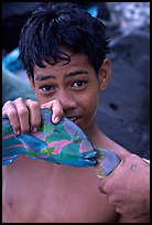 Samoan boy with freshly catched tropical fish, Tau Island. National Park of American Samoa (color)
