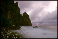 Peeble beach and Pola Island, stormy sunrise, Tutuila Island. National Park of American Samoa