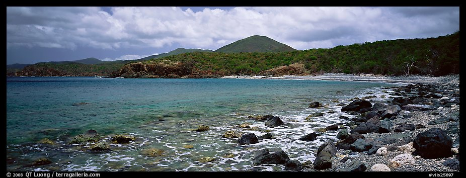 Bay lined with boulders and verdant hills. Virgin Islands National Park (color)