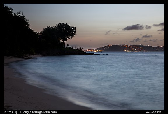 Honeymoon beach at dusk with lights of St Thomas. Virgin Islands National Park (color)