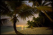 Salomon beach with distant lights at night. Virgin Islands National Park, US Virgin Islands.