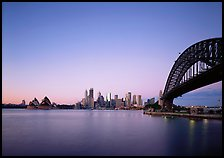 Harbor Bridge, skyline, and Opera House, dawn. Sydney, New South Wales, Australia