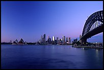 Harbour bridge, city skyline and opera house, dawn. Sydney, New South Wales, Australia