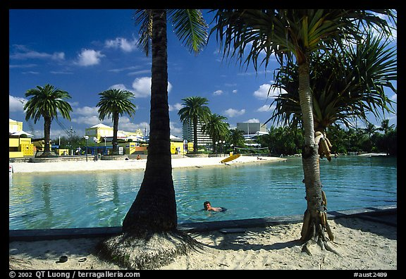 Artificial beach, complete with sand and palm trees. Brisbane, Queensland, Australia (color)