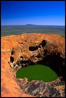 Green pool on Ayers Rock, Olgas in a distance. Uluru-Kata Tjuta National Park, Northern Territories, Australia ( color)
