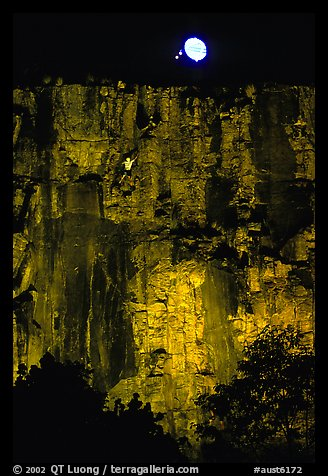 Rock climbing on the banks of the Brisbane River at night. Brisbane, Queensland, Australia