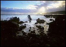 Rocks and surf at sunrise, Keanae Peninsula. Maui, Hawaii, USA