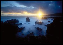Sun shining brilliantly over primeval seascape, Kenae Peninsula. Maui, Hawaii, USA (color)