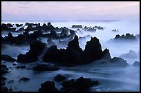 Volcanic rocks and waves at sunrise, Keanae Peninsula. Maui, Hawaii, USA (color)