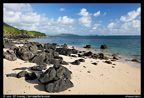 Volcanic rocks and beach, near Makai research pier,  early morning. Oahu island, Hawaii, USA (color)