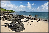 Volcanic rocks and beach, near Makai research pier,  early morning. Oahu island, Hawaii, USA