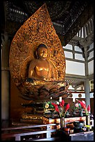 Amida seated on a lotus flower, the largest Buddha statue carved in over 900 years, Byodo-In Temple. Oahu island, Hawaii, USA