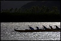 Backlit outrigger canoe, Maunalua Bay, late afternoon. Oahu island, Hawaii, USA (color)