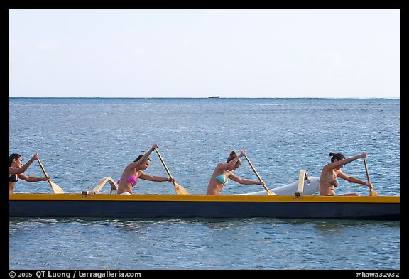 Side View Of Women In Bikini Paddling A Outrigger Canoe Maunalua Bay Late Afternoon Oahu Island Hawaii USA