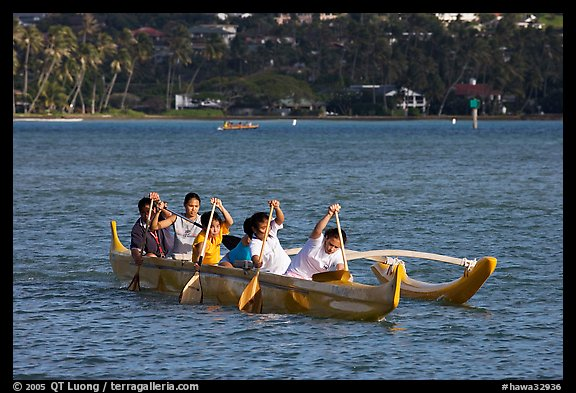 Girls paddling an outrigger canoe, Maunalua Bay, late afternoon. Oahu island, Hawaii, USA (color)