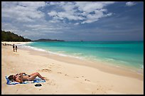 Woman sunning herself on Waimanalo Beach. Oahu island, Hawaii, USA ( color)