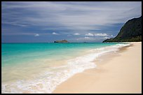 Sand, turquoise waters, and pali, Waimanalo Beach. Oahu island, Hawaii, USA