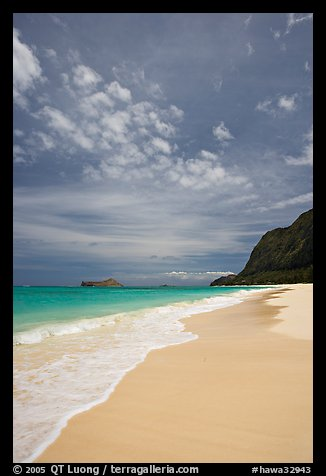 Sand, turquoise waters, and cliff, Waimanalo Beach. Oahu island, Hawaii, USA (color)