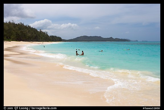 Couple and other bathers in the water, Waimanalo Beach. Oahu island, Hawaii, USA (color)