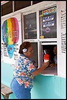 Woman with a flower in her hair getting shave ice, Waimanalo. Oahu island, Hawaii, USA (color)