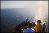 Men above the Makapuu head ligthouse, early morning. Oahu island, Hawaii, USA (color)