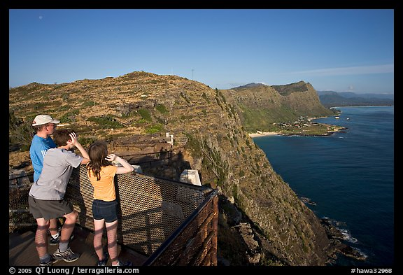 Family on the lookout on the summit of Makapuu head, early morning. Oahu island, Hawaii, USA