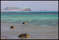 Rocks and turquoise waters near Makai research pier. Oahu island, Hawaii, USA