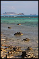 Rocks and turquoise waters near Makai research pier. Oahu island, Hawaii, USA ( color)