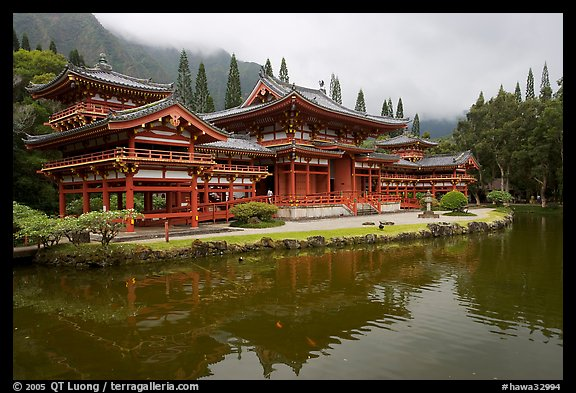 Byodo-In temple reflected in pond on a cloudy day. Oahu island, Hawaii, USA (color)