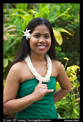 Tahitian woman making the traditional welcome gesture. Polynesian Cultural Center, Oahu island, Hawaii, USA (color)